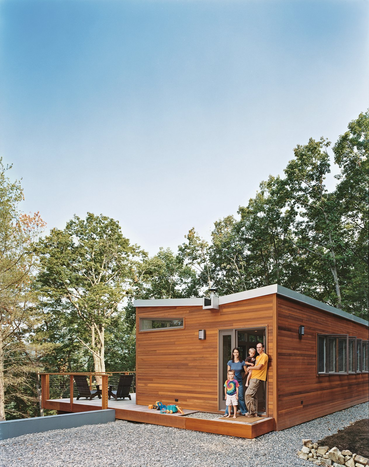 Exterior, Wood Siding Material, Cabin Building Type, House Building Type, Prefab Building Type, and Butterfly RoofLine At the end of a steep driveway, off a road less graveled, await the happy innkeepers: Chris Brown, Sarah Johnson, and Michael and Joshua, two of their three sons.  Photo 45 of 101 in 101 Best Modern Cabins from Take Me Home