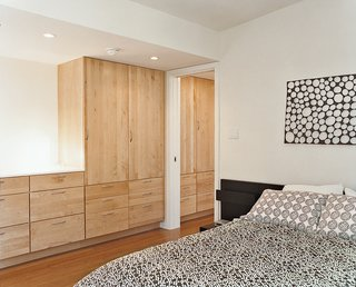 In the bedroom, a hanging mobile by Oras over the headboard makes a big difference.