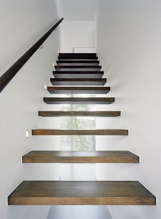 Sum of Its Parts - Photo 6 of 12 - Arkitekthus charges a little extra for the see-through staircase; the basic house has under-staircase storage, which is more practical but less beautiful.