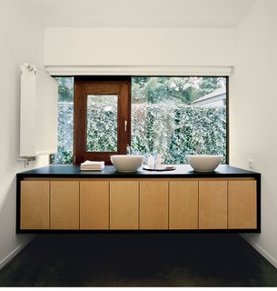 The bathroom mirrors the same materials, colors, and design principles as the rest of the building.
