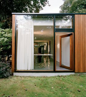 The exterior is clad in louro gamela, a tropical hardwood.