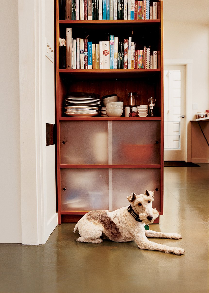 Storage Room and Shelves Storage Type Sparky the wirehaired fox terrier takes a load off in front of one of the cherry-ply cabinets with sanded acrylic doors that Azevedo built for the kitchen.  Photo 3 of 9 in Bay Wash