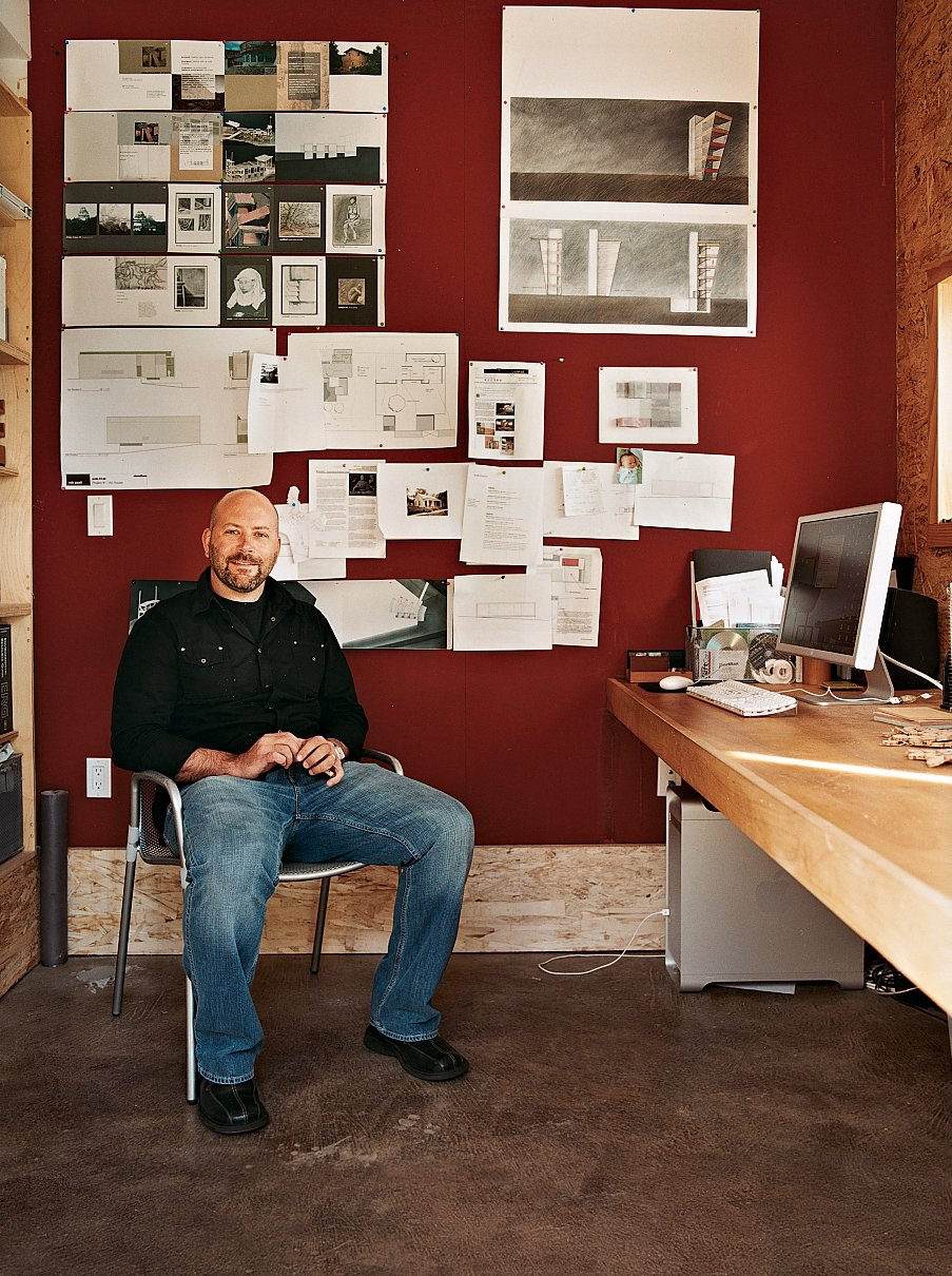 """Pyatt's office is the sparest room in the house, with the straw panels """"left raw to give a sense of the monolithic nature of those walls,"""" according to Pyatt. Tagged: Office and Desk.  Photo 6 of 9 in Post Bale"""