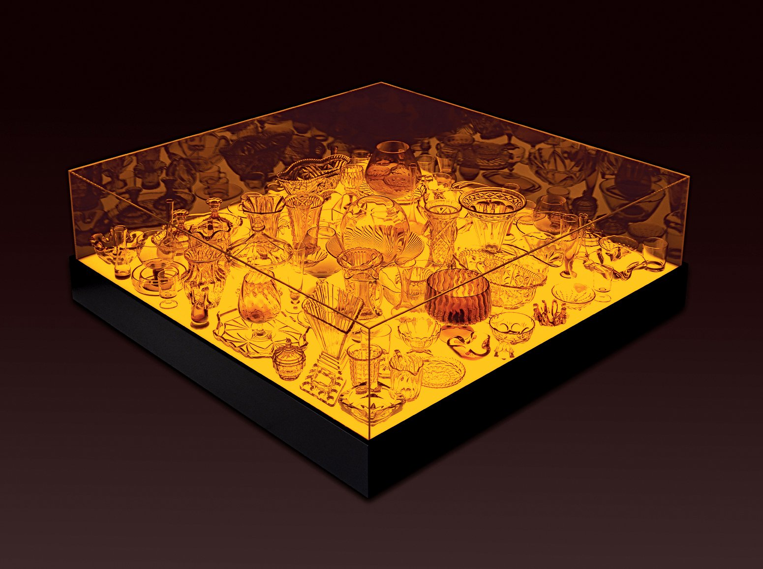 The 2006 Aladdin table, which houses an assemblage of glass pieces within an amber light box.  Photo 5 of 13 in Design Junkie