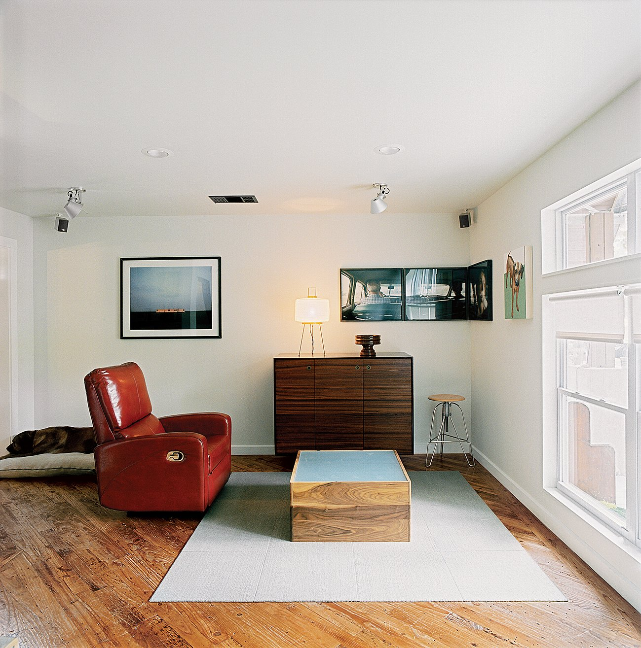 Living Room, Medium Hardwood Floor, Rug Floor, and Chair The media cabinet and lightbox coffee table exemplify Dollahite's furniture-making talents. After finishing the house he founded a studio, Rural Theory, to apply his talents elsewhere.  Photo 6 of 10 in Salvage Love