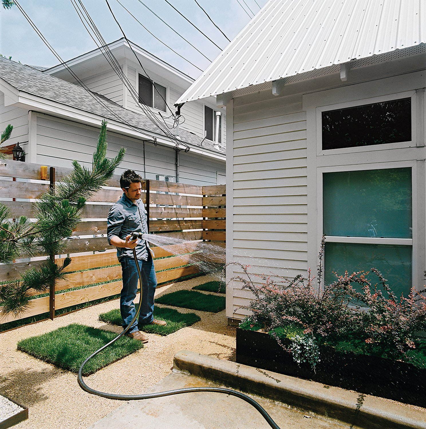 Outdoor and Gardens Dollahite tackled landscaping last, installing climate-sensitive plants in metal planters he designed himself.  Photo 8 of 10 in Salvage Love
