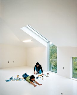 To add extra illumination to the third floor loft, Wibowo placed Dan Flavinesque sculptural (and inexpensive) four-foot-long fluorescent tubes into the slanted ceiling.