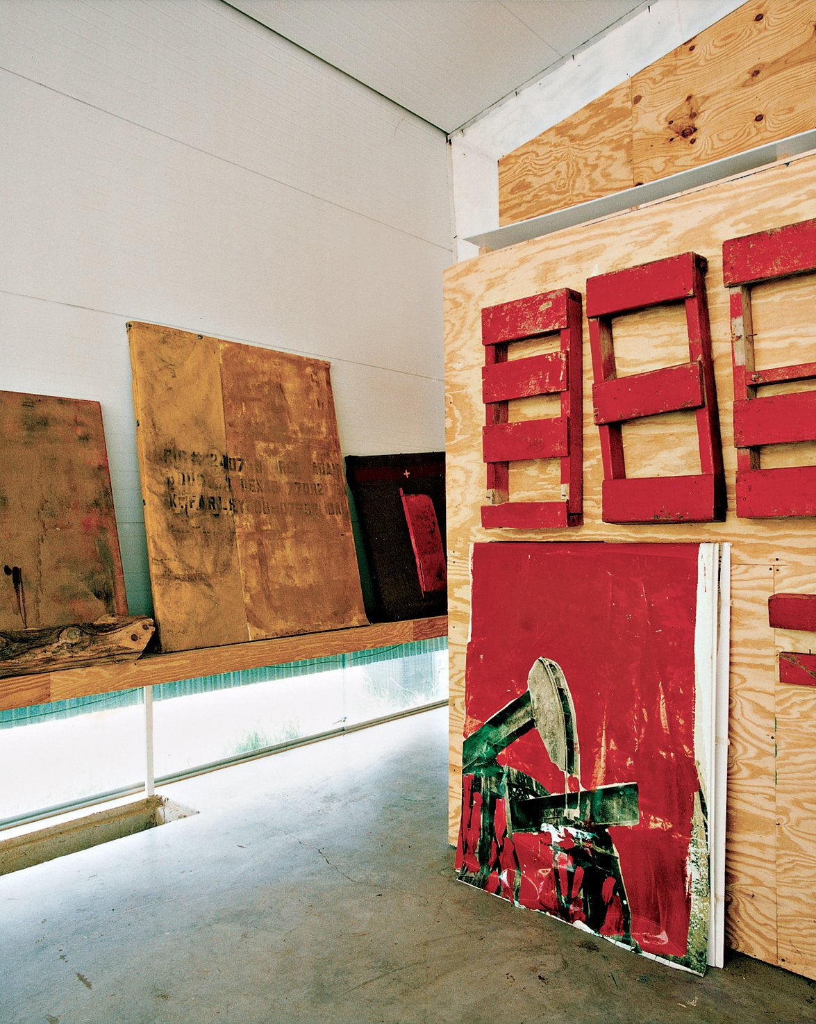 Kyle Farley's paintings lean against walls and lie across the floor in various phases of progress. The bare plywood, metal, and concrete create an unornamented and distraction-free space in which Farley's vivid, large-scale works can come to life.  Photo 3 of 13 in Lone Star