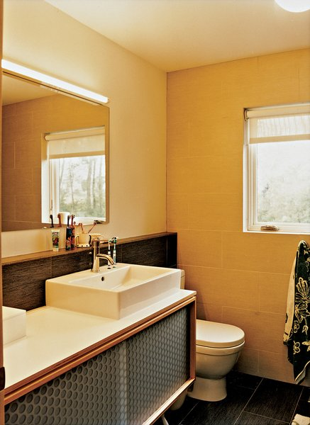 The childrens' bathroom, which is just off the central hallway.  Photo 6 of 9 in Affordable, SIP-Built Family Home in Kansas City