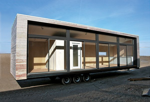"""Upwardly Mobile Homes - Photo 3 of 6 - Architect Christopher C. Deam's Glassic Flat attempts to put the """"pre"""" back into prefab: When the unit leaves the Breckenridge factory on the flatbed of a stylish big rig, it is ready for occupation."""