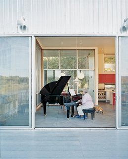 The architects built the house around Madeline's grand Schimmel piano. But that's not to say the pair wanted to live in a concert hall. Having a flexible living space and accommodating recital guests took priority.