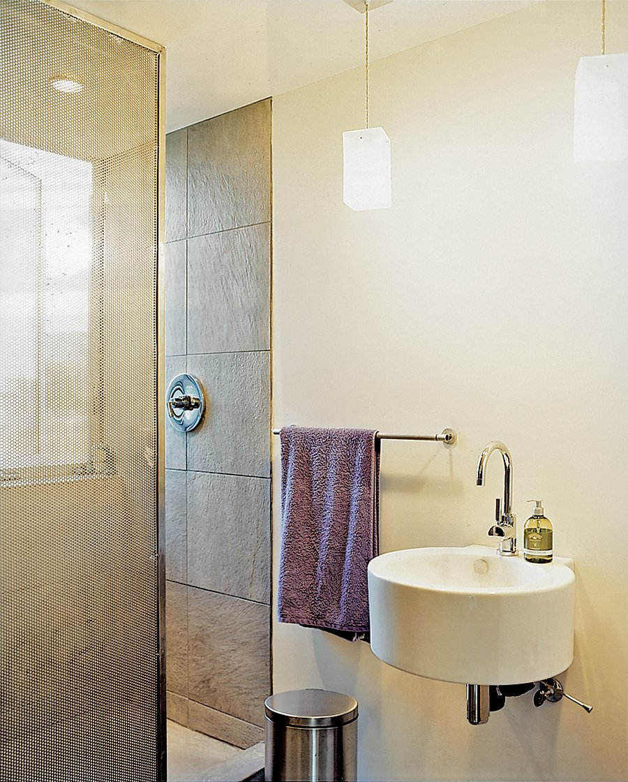 A perforated metal screen serves as a shower curtain.  Photo 9 of 10 in Abiquiu Debut
