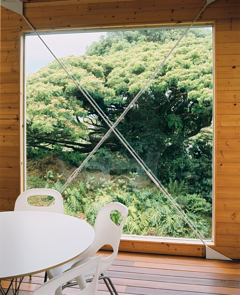 A huge window next to the dining area is punctuated by a steel X form.  Photo 5 of 9 in Lava Flow 4, The Big Island