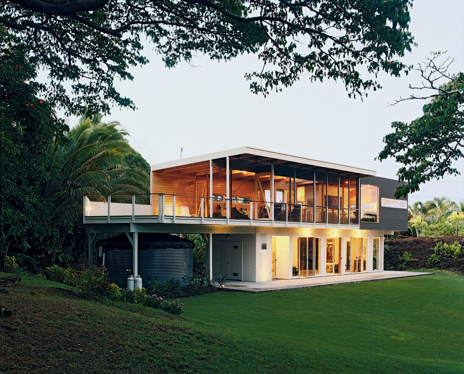 Grass, Exterior, Metal Siding Material, and House Building Type Ipe decking extends from the actual deck to the home's interior.  Photo 8 of 9 in Lava Flow 4, The Big Island