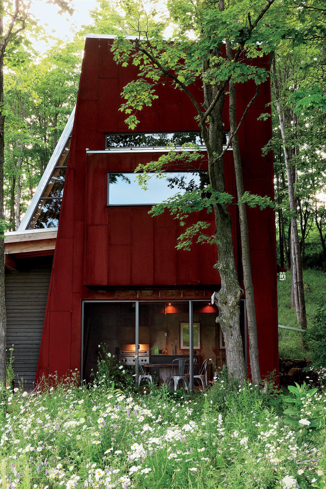 The screened-in porch. Tagged: Exterior, Metal Roof Material, and Metal Siding Material.  Photo 8 of 8 in Scrap House