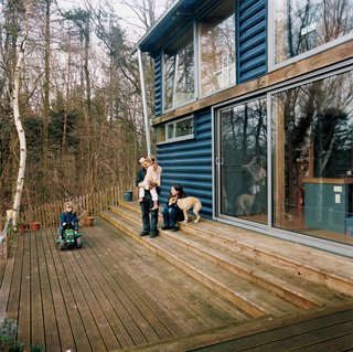 The addition includes a large timber deck at the front, where the family can lounge and enjoy the lush scenery.