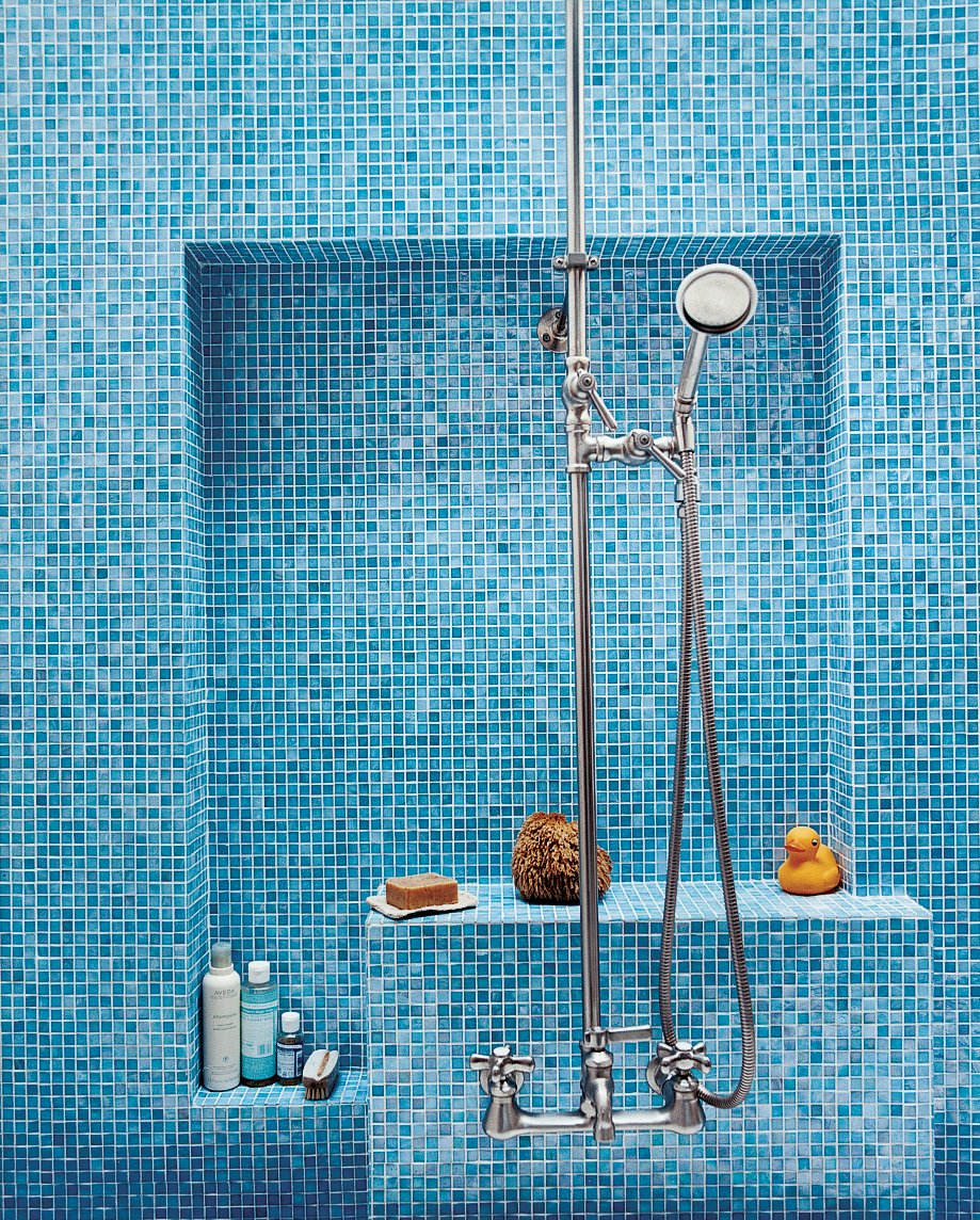 The bathroom glows with various shades of Turkish-style glass tiles (in Iris) from Galleria Tile in San Francisco; the custom nickel-plated hardware is from Chicago Faucets.  Photo 2 of 9 in Mission Statement