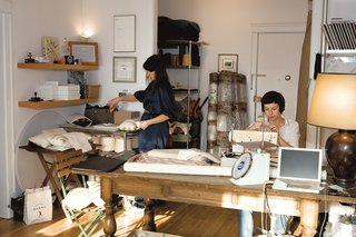 Mademoiselle Pillow - Photo 1 of 1 - In her sunny studio, Joanna Notkin (left) assembles pillows while Anna Borstand, who manages sampling and production, carefully threads a needle.