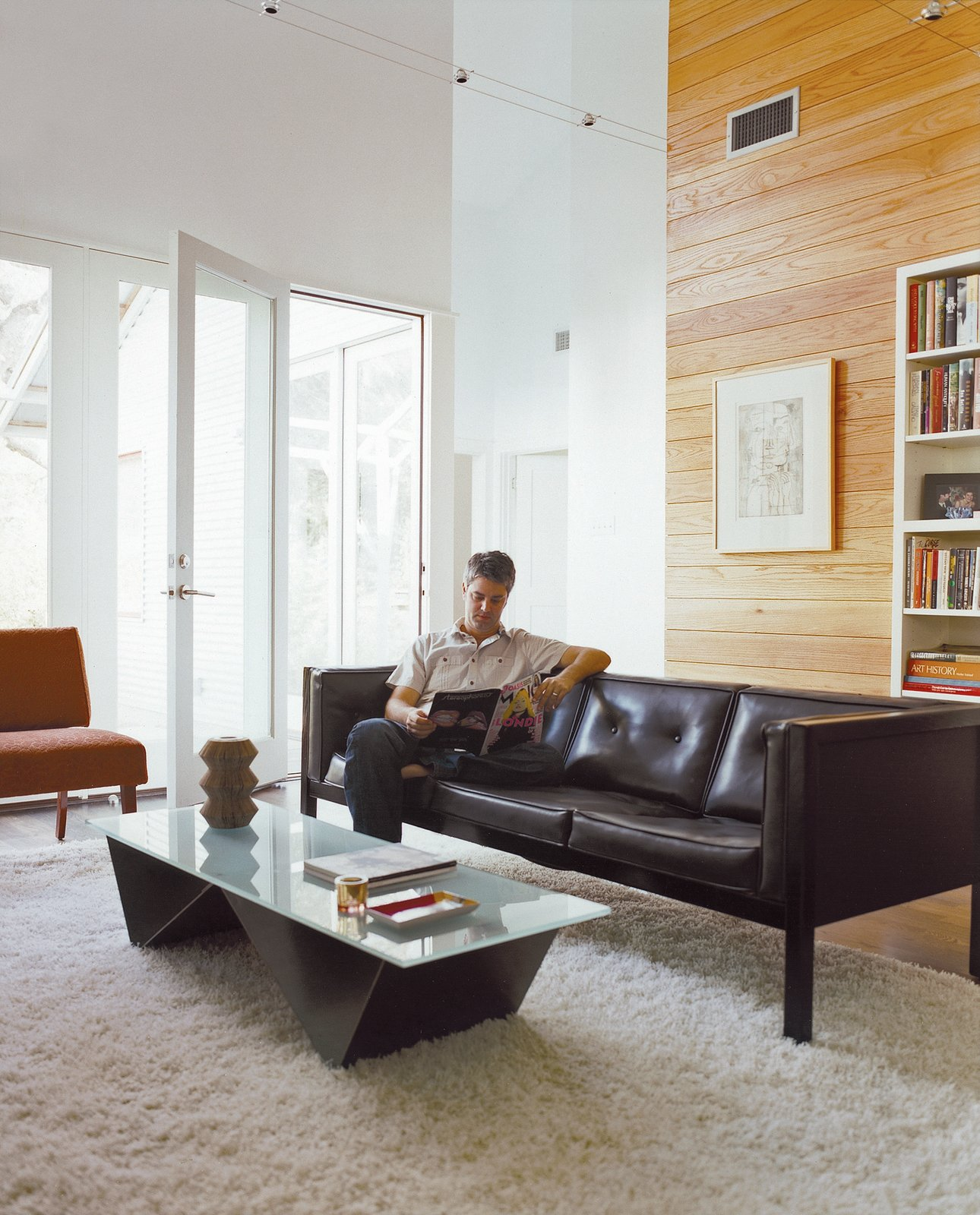 The living room isn't large, but its high ceiling makes it feel airy, and furniture on slender legs allows light and air to circulate through the space.  Photo 3 of 7 in Double Time