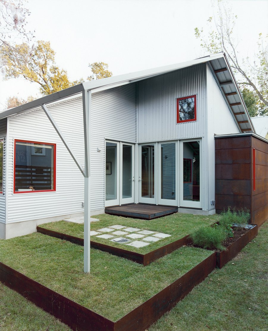 A back patio, designed by Allison's sister, Jennifer Orr, a landscape architect, opens to the living room and to the office.  Photo 7 of 7 in Double Time