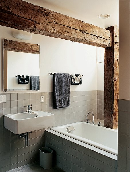 Bath Room Rather than concealing the barn frame in the private rooms, Cohen created an interplay between modern and historic elements in the master bathroom.  Photo 5 of 7 in Raising the Barn