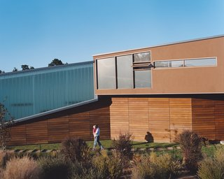 Untraditional in Marin - Photo 4 of 4 - The Shermans' home is designed to blend effortlessly with the hillside on which it rests by using a muted material palette of troweled plaster and cedar planking.