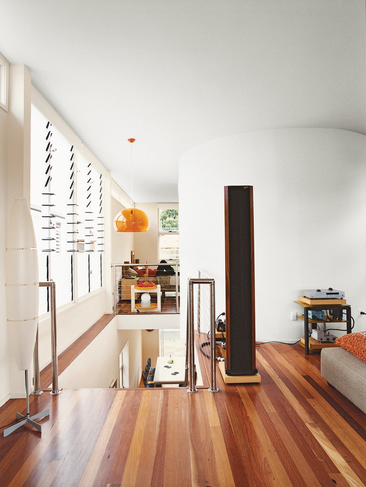 The black column in his living room is not a mysterious monolith, but one of his speakers.  Photo 6 of 8 in Minimalist Bachelor Pad in Brisbane