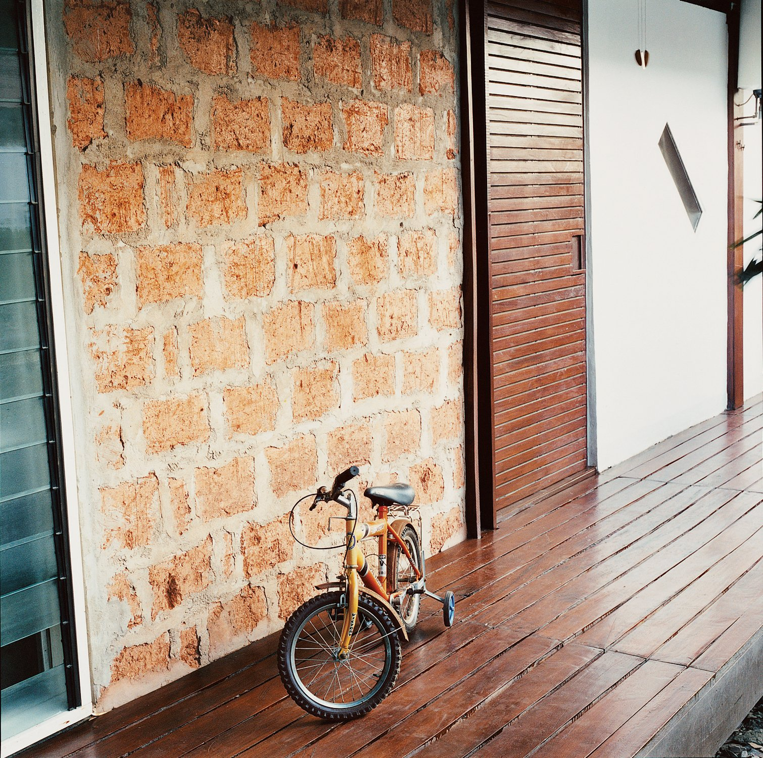Kwaku's bike sits near the adobe wall.  Photo 2 of 9 in An Inno-native Approach