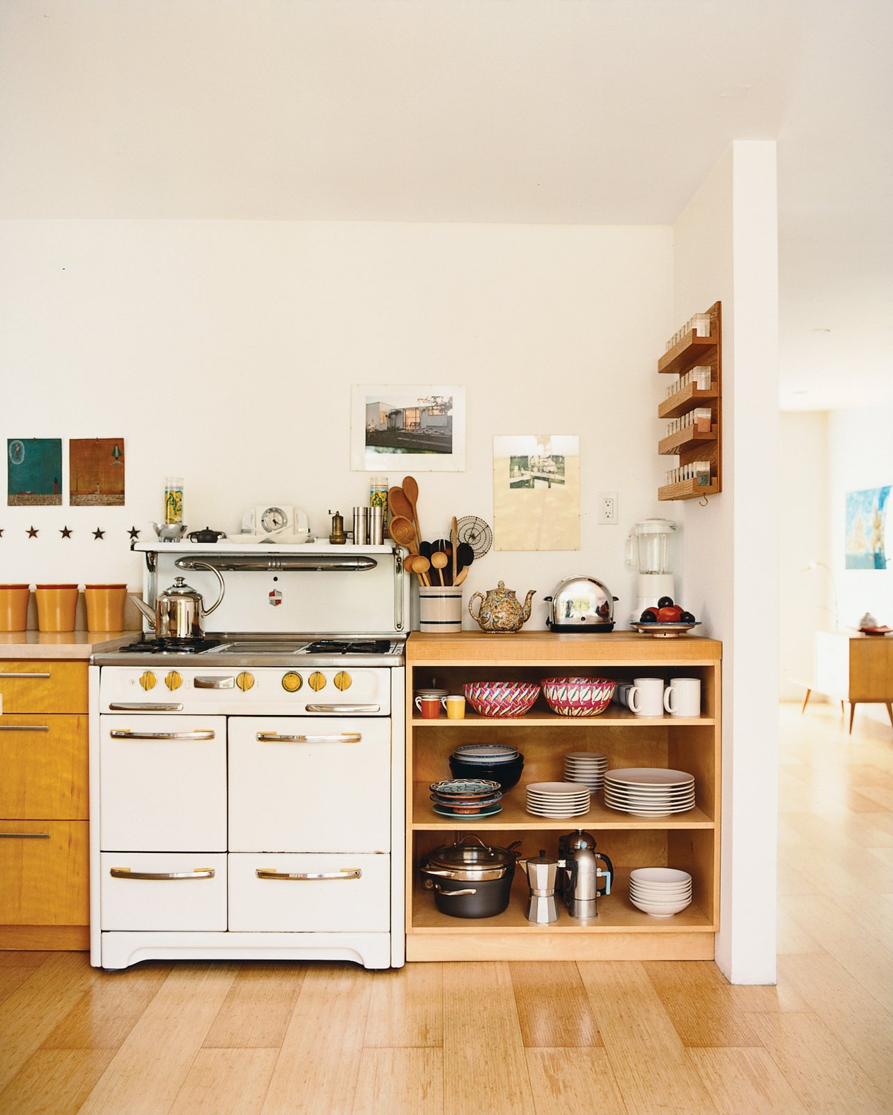"Cooktops, Light Hardwood Floor, Storage Room, and Shelves Storage Type ""A lot of the things in here are found objects,"" Siegal says of her home's contents. The vintage stove, with its funky yellow Bakelite knobs, was inherited from the previous owner.  Photo 4 of 14 in Method Lab"