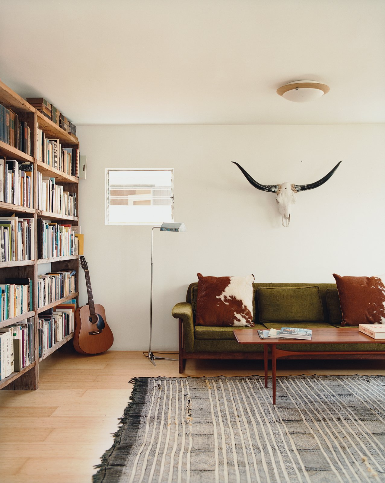 Living Room, Light Hardwood Floor, and Sofa Siegal built bookshelves from scrap wood, bartered for her Danish modern furniture, and haggled for a living-room rug in Morocco.  Photo 5 of 14 in Method Lab
