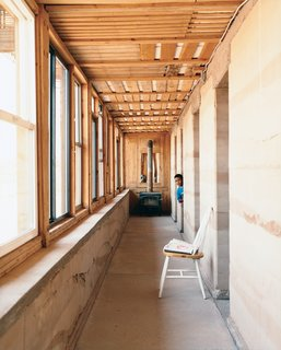 In wintertime, the rammed earth hallway wall serves as the central heating device, soaking up sunlight through south-facing windows and distributing warmth throughout the house. A wood-burning stove at the end of the front hallway provides additional heat for cold winter nights.