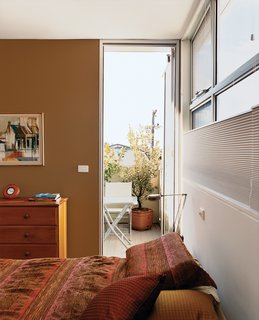 A small balcony off the master bedroom is both a sheltered area for reading and a crucial device for creating cross breezes.