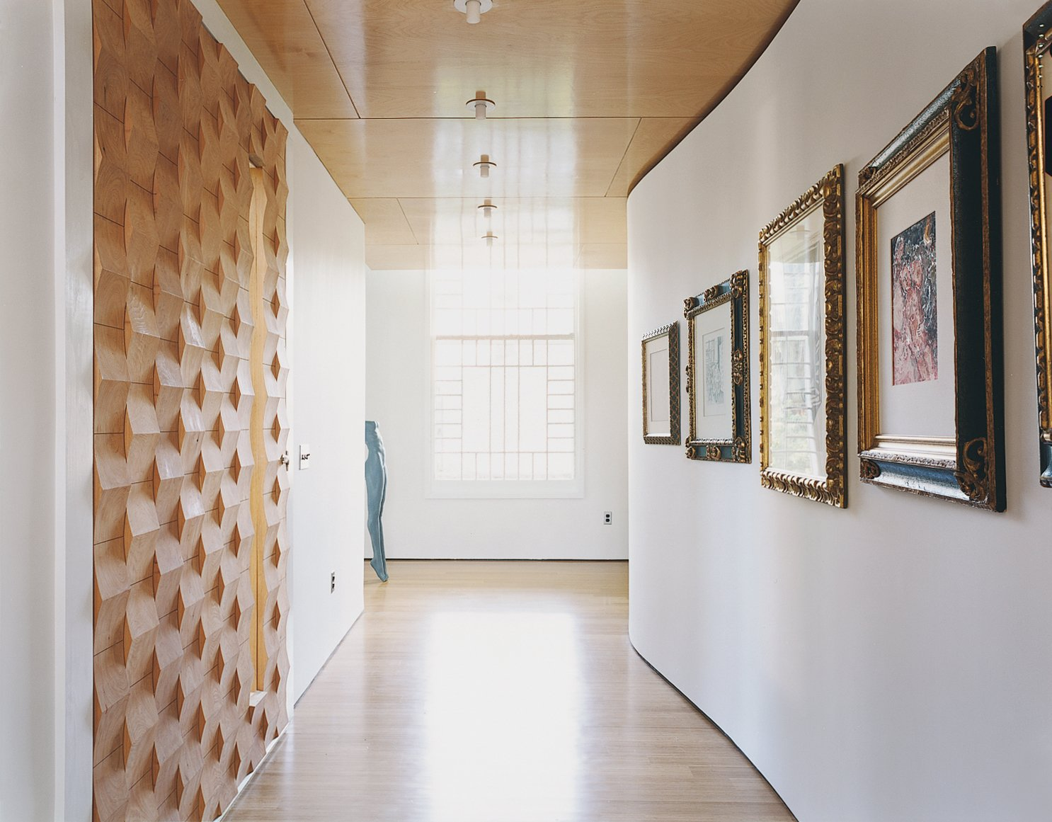The house is as much a work of art as a showcase for it. The Suarezes are catholic in their tastes: They buy for love not investment, their collection a mix of high and low. In the foyer, prints and drawings acquired over the course of their world travels hang along the attenuated S-curve of the wall opposite the front door.  Photo 3 of 10 in At Home in a Modern Church