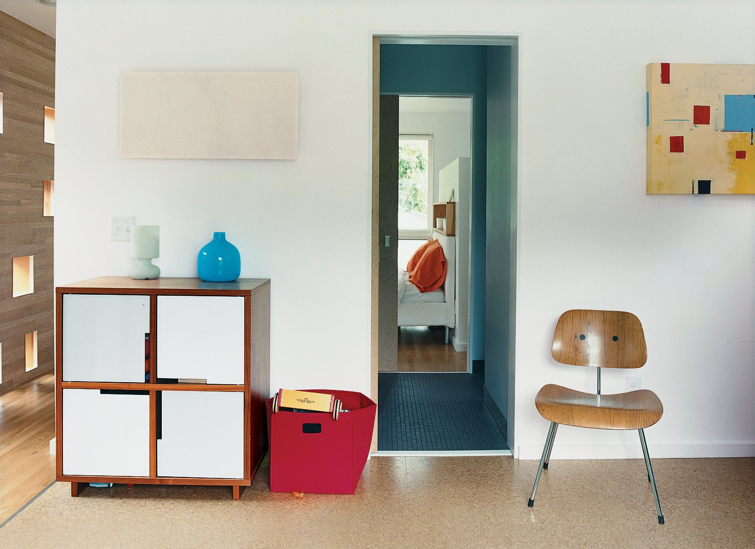 """Bedroom A BluDot hutch and yellow painting by Minneapolis artist Ellen Richman occupy one end of the new """"swingroom"""", which connects the original house to one of the two additions.  Photo 3 of 9 in Minneapolis, MN"""