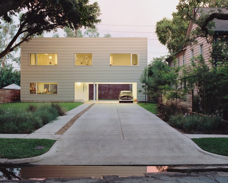 Architects Dawn Finley and Mark Wamble's 1,200-square-foot house in Houston, Texas, is clad in corrugated metal and contains their five-person firm, Interloop—Architecture.  Photo 2 of 12 in Houston, TX