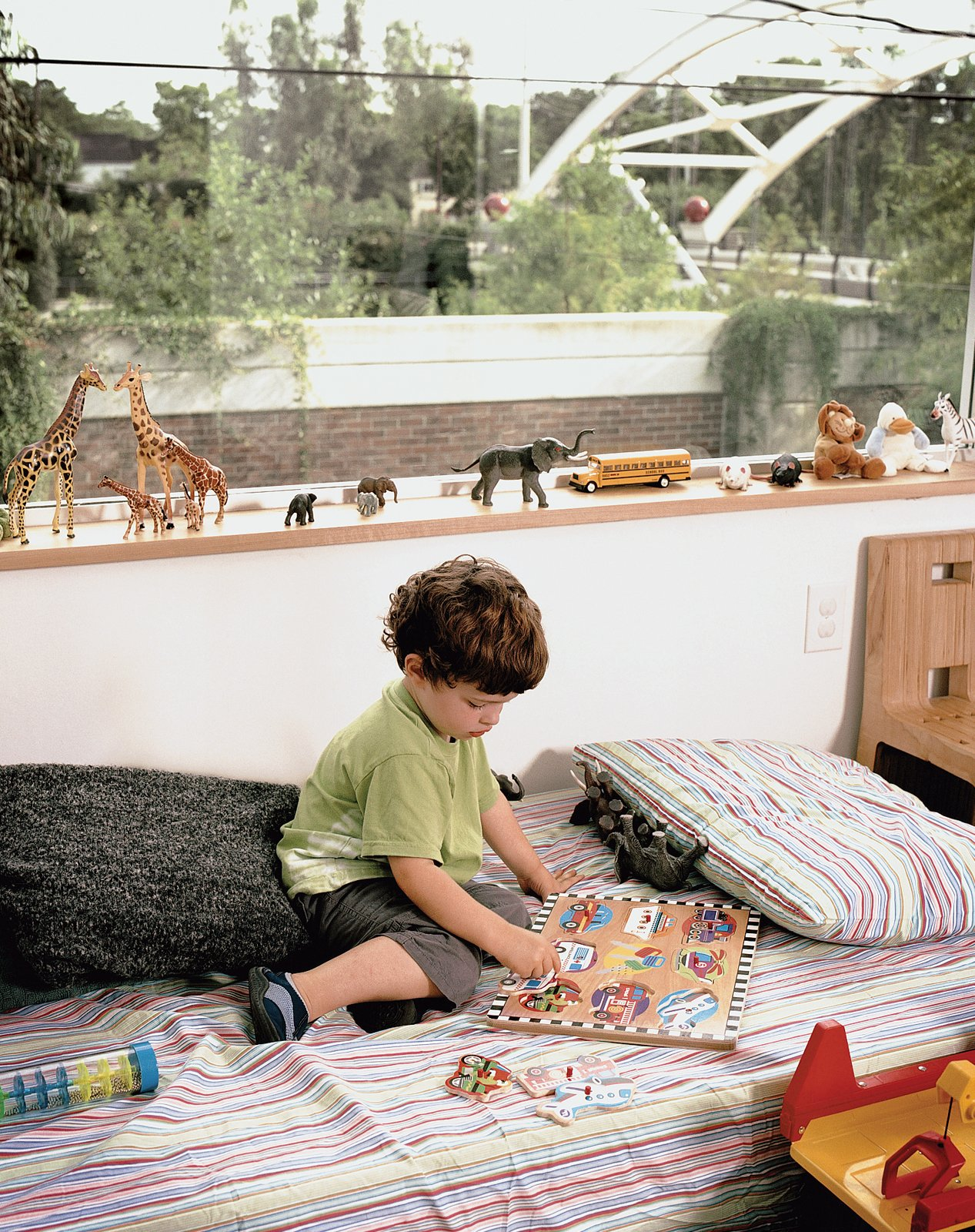 Kids Room and Bedroom Room Type Leroy with his menagerie and the highway-spanning bridge beyond.  Photo 6 of 12 in Houston, TX