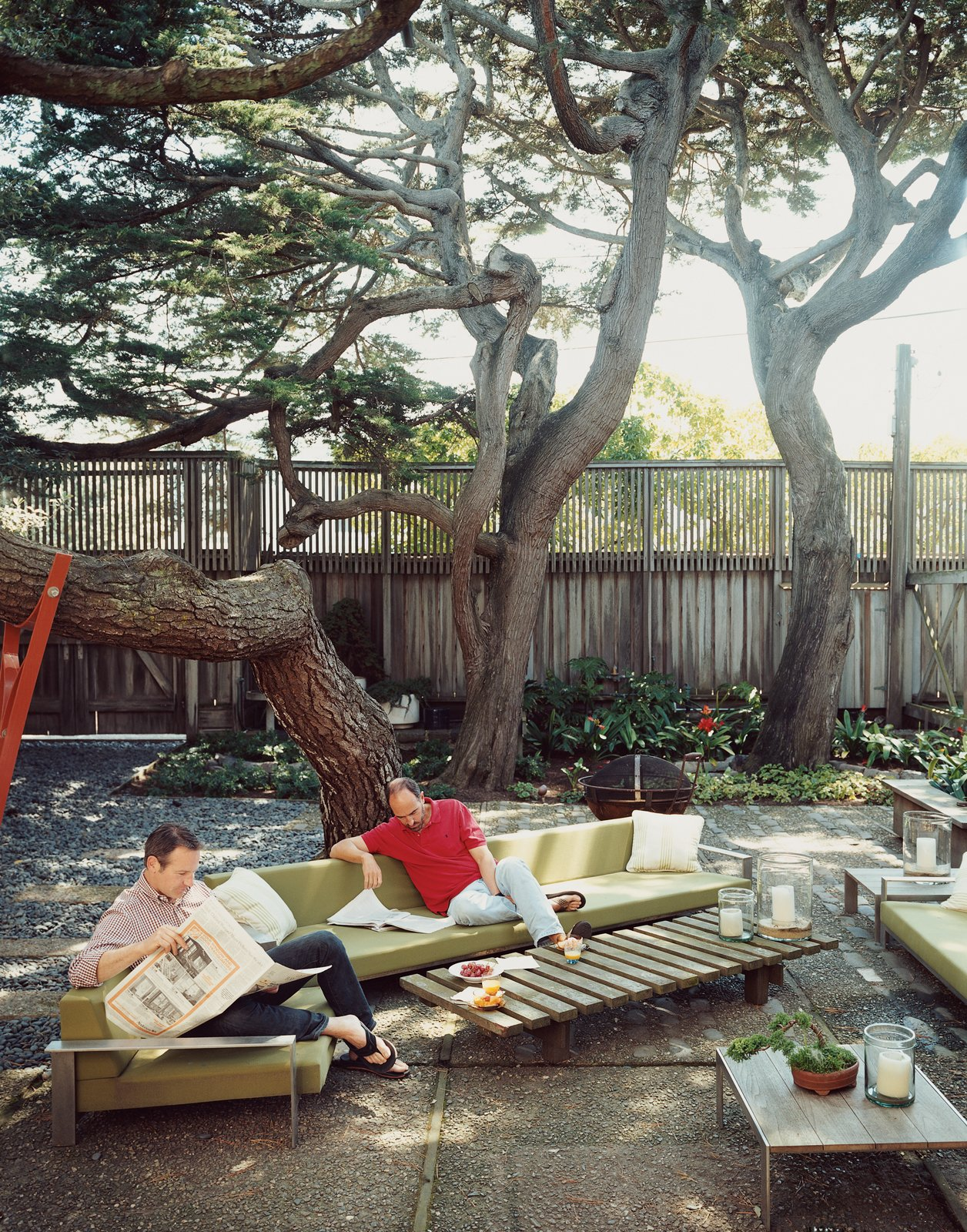 Zelen (left) and Lloyd-Butler take advantage of their shady outdoor space.  Photo 12 of 13 in This Surfer's Beach House is More Than It Seems