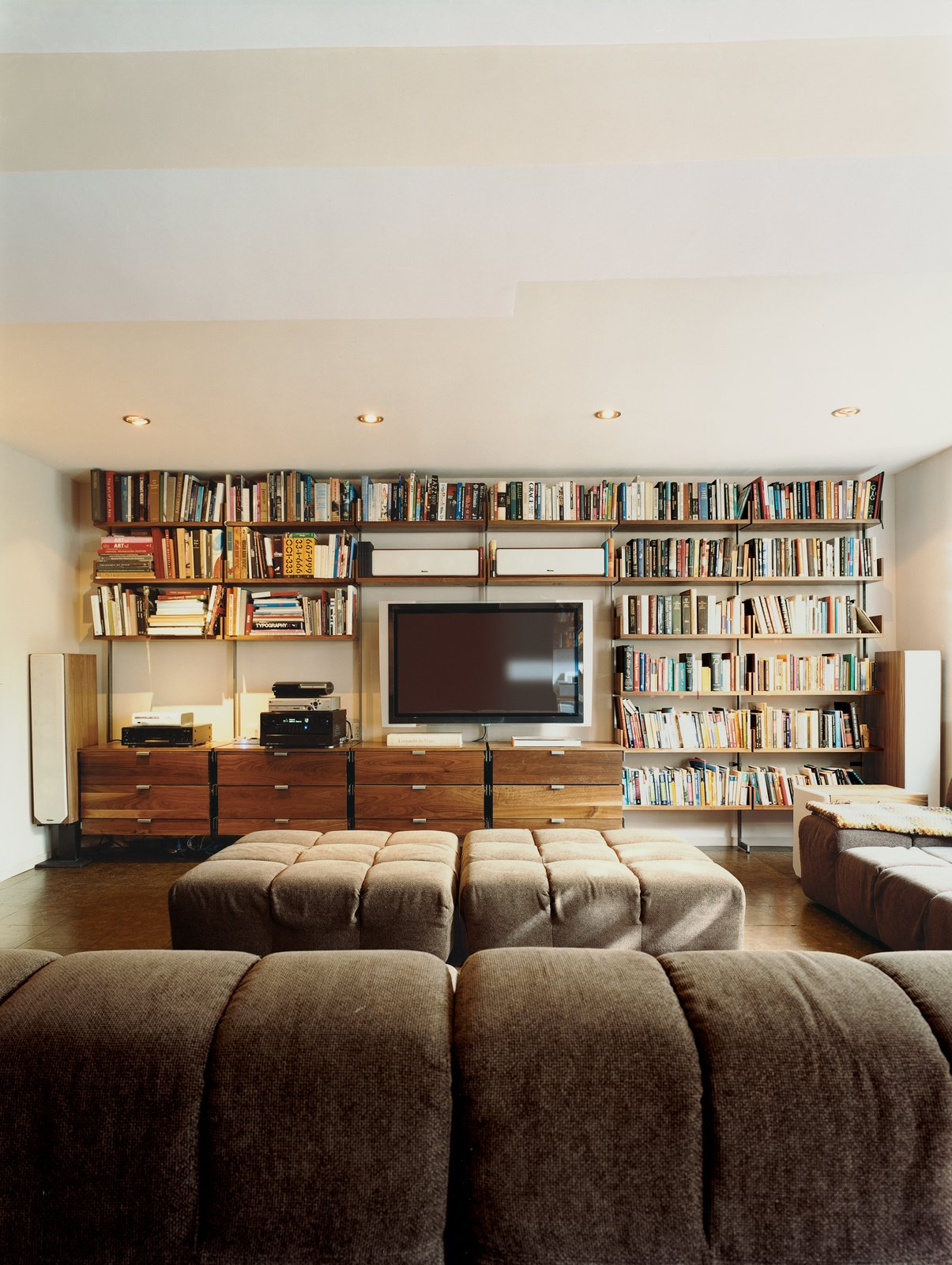 Living Room, Ottomans, Sofa, and Recessed Lighting Atlas shelving provides the framework for Farnham's entertainment center. Almost 100 square feet of Patricia Urquiola's Tufty-Time sofa for B&B Italia provides ample space to stretch out.  Photo 12 of 14 in Mid-Century Mash-Up