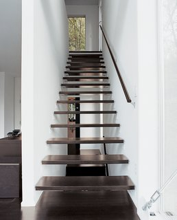 Aloft in the Forest - Photo 6 of 8 - Interior wood stairs are pared with a top-floor steel staircase outside.