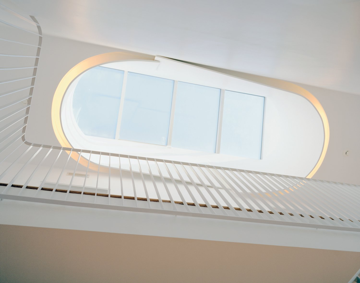 Windows and Skylight Window Type Briggs and Knowles based their design of the oculus on traditional Victorian skylights but tweaked it to fit a more modern sensibility and outfitted it with fluorescent tubing to recreate the effect in the evening.  Photo 2 of 7 in Modern Rowhouse Renovation in New York