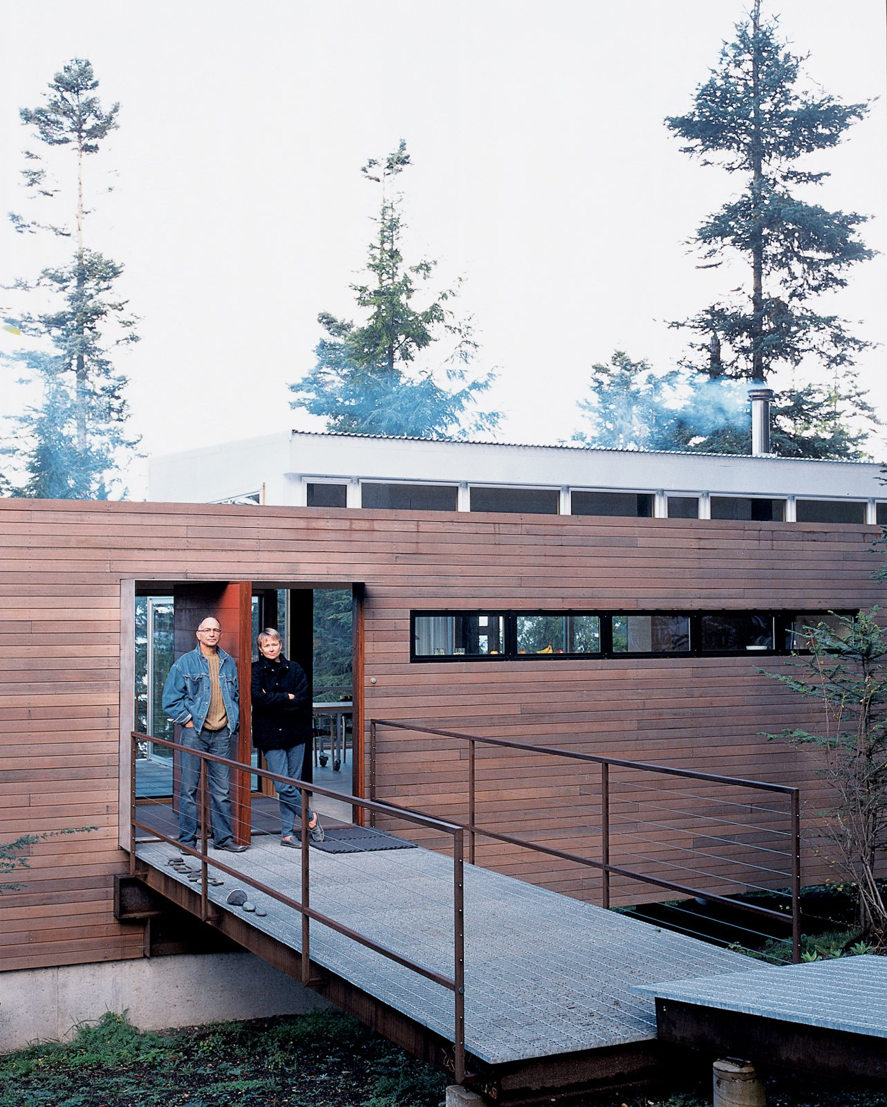 Galvanized steel is used to bridge the gap between natural landscape and structure in the entryway of the house. Tagged: Exterior, Metal Roof Material, Flat RoofLine, House, and Wood Siding Material.  Photo 2 of 4 in Washington State Vacation Home Sets the Stage
