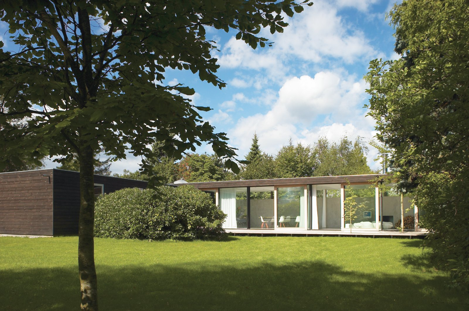 Exterior, Mid-Century Building Type, Flat RoofLine, and House Building Type The main living space is constructed of immense I-profiles, allowing for a full wall of glass with four large sliding doors that open to the backyard.  Photo 1 of 6 in We Summer in the Hamptons