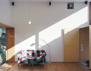 """The official """"living room"""" may be the least-frequented locale, since the house and garden combine to create one big, interconnected living space. The whole was conceived as a modern take on the traditional Japanese sheltered veranda, or """"engawa."""""""