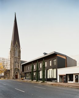 Referencing the First Presbyterian Church's slate roof, 12 + Alder makes nice to its divine neighbor.