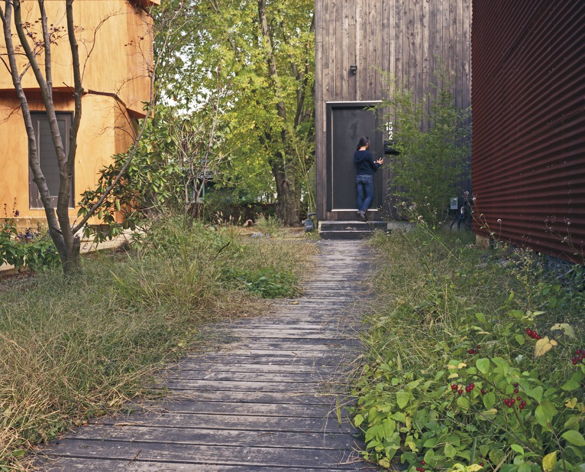 The overgrown boardwalk leading up to Medium's entrance feels more Martha's Vineyard than North Cambridge.  Photo 3 of 11 in Four Houses and a Future