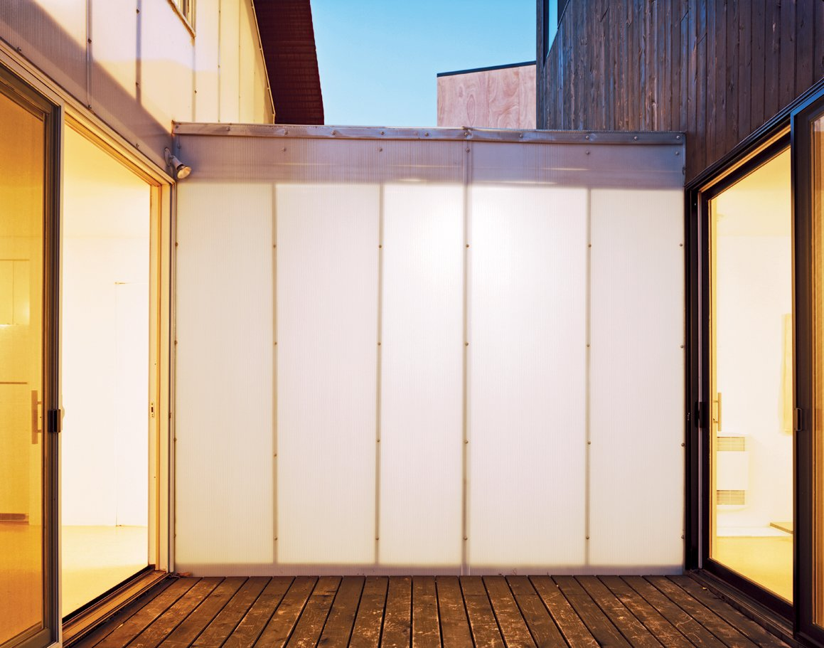 A translucent Polygal corridor separates Small and Medium.  Photo 10 of 11 in Four Houses and a Future