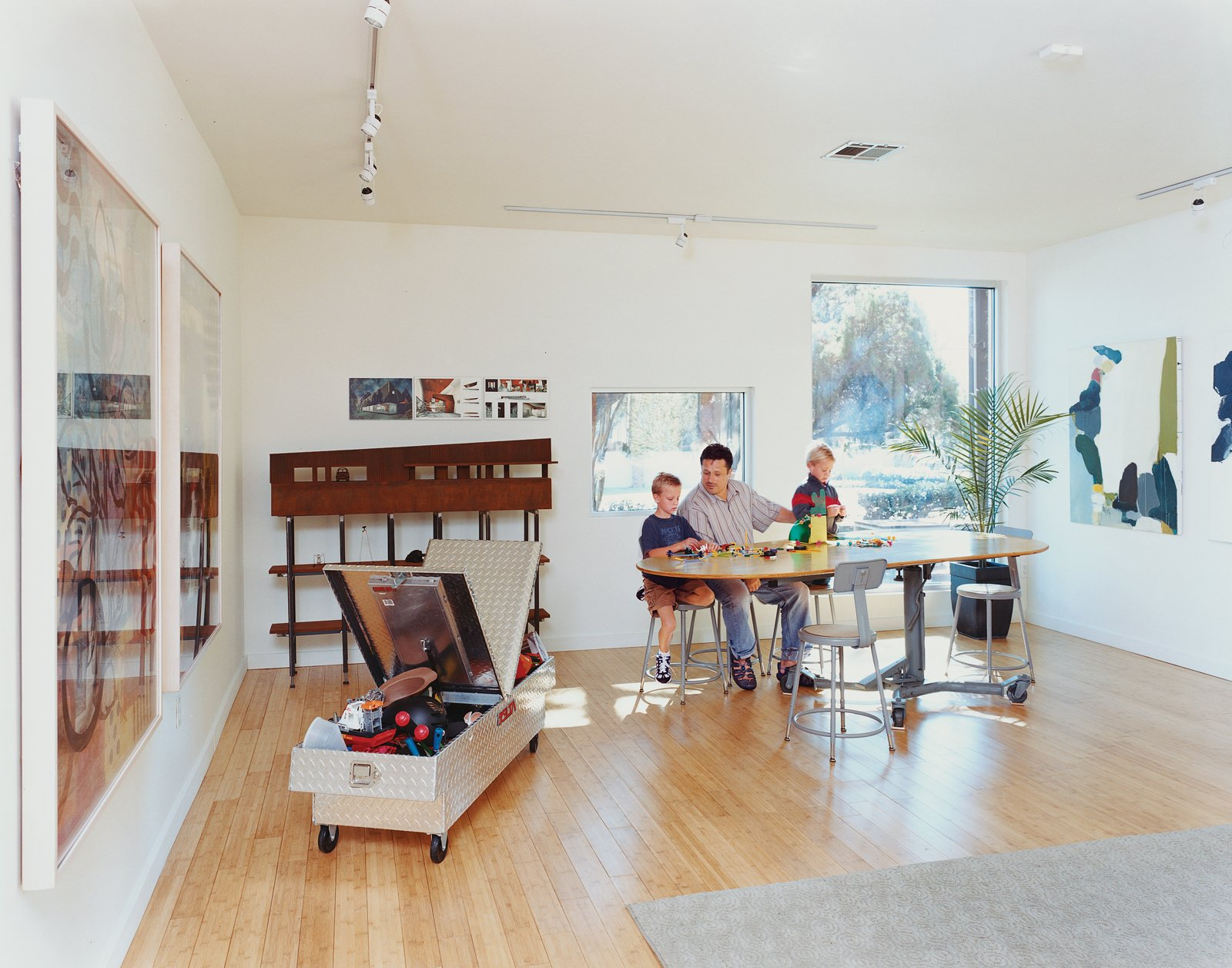 Bo and Sky get a building lesson from dad on a custom table designed by Baird and his studio.  Photo 8 of 13 in Baton Rouge Oasis