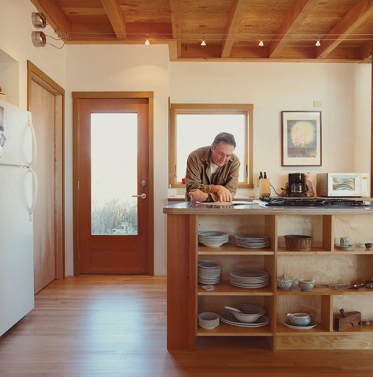The residence features quiet, poetic spaces, such as the kitchen.  Photo 5 of 12 in Labor of Loved Ones