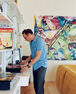 Community Building - Photo 2 of 10 - Randy Rapaport can't get enough of his favorite band, the Flaming Lips, and happily whiles away the hours spinning their records in his 1,000-square-foot loft. On the wall is a painting by Timothy Scott Dalbow that Rapaport picked up from the nearby New American Art Union Gallery.