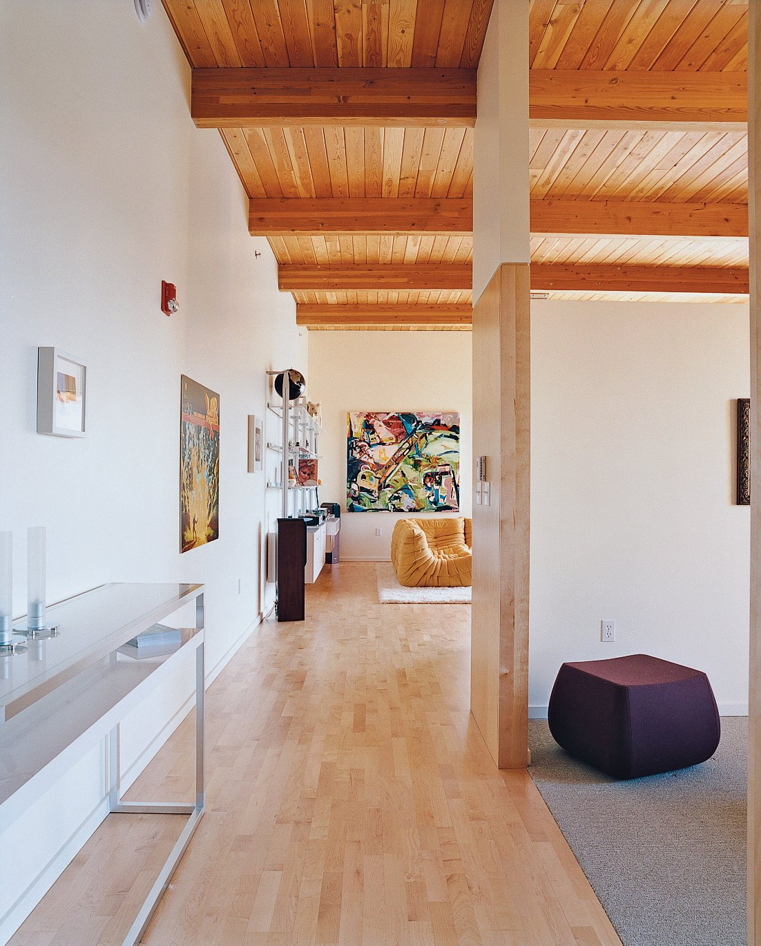 Hallway, Light Hardwood Floor, and Carpet Floor Although the loft is relatively small, high ceilings and an open floor plan give it room to spare.  Photo 6 of 8 in 8 Examples That Show How Loft Living Goes Beyond Just NYC from Community Building